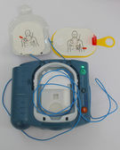 Automated External Defibrillator and pads activated — Stock Photo