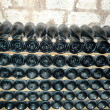 Royalty-Free Stock Photo: Champagne bottles stored in a cellar during fermentation