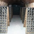 Champagne bottles stored in a cellar during riddling — Stock Photo