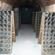 Foto Stock: Champagne bottles stored in cellar during riddling