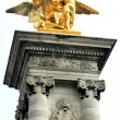 Golden statue on Pont Alexandre III in Paris - Stock Photo