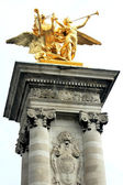 Golden statue on Pont Alexandre III in Paris — Stock Photo