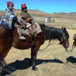 Mother and two kids on horse at Sani Pass, Lesotho — Stock Photo