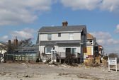 Destroyed beach property for sale in devastated area four months after Hurricane Sandy on February, 28, 2013 in Far Rockaway, NY — Stock Photo