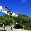 Stock Photo: Dramatic plane landing at St Barth airport, French West Indies, Caribbean