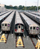 Old and new New York subway trains at the train depot — Foto de Stock