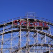Historical landmark Cyclone roller coaster  in the Coney Island section of Brooklyn. Cyclone is a historic wooden roller coaster opened on June 26, 1927 - Stock Photo