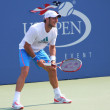 Professional tennis player Juan Monaco practices for US Openat Billie Jean King National Tennis Center - Stock Photo
