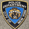 Stock Photo: NYPD emblem on fallen officers memorial in Brooklyn, NY.