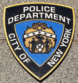 NYPD emblem on fallen officers memorial in Brooklyn, NY. — Stock Photo