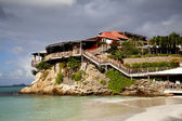 The beautiful Eden Rock hotel and rainbow at St Barth, French West Indies. — Stock Photo