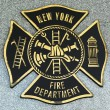 FDNY emblem on fallen officers memorial in Brooklyn, NY. - Stock Photo