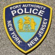 Stock Photo: Port Authority Police New York New Jersey emblem on fallen officers memorial in Brooklyn, NY