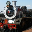 Stock Photo: Pride of Africsteam train about to depart from Capital Park Station in Pretoria