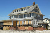 Destroyed beach houses in devastated area six months after Hurricane Sandy — Stock Photo