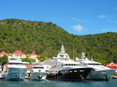 Mega yachts in Gustavia Harbor at St. Barths — Stock Photo