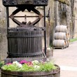 Old wine press and barrels at the vineyard — Stock Photo