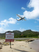 Small plane taking off from St Barths airport — Stock Photo