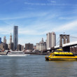 New York City Water Taxi and  SeaStreak ferry boat ride in Lower Manhattan - Stock Photo