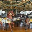 Horses on a traditional fairground carousel — Stock fotografie #25226683