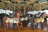 Horses on a traditional fairground carousel — Stock Photo