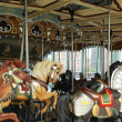 Stock Photo: Horses on traditional fairground carousel