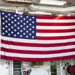 Huge American flag inside the deck of US Navy destroyer during Fleet Week 2012 — Stock fotografie
