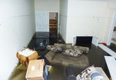 Completely flooded basement next day after Hurricane Sandy in Staten Island. — Stock Photo