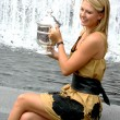 Постер, плакат: US Open 2006 champion Maria Sharapova holds US Open trophy after her win the ladies singles final