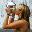 Постер, плакат: US Open 2006 champion Maria Sharapova kisses US Open trophy after her win the ladies singles final