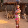 Stock Photo: Zulu womin traditional closes in Shakaland Zulu Village, South Africa