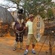 Stock Photo: Zulu Chief posing with tourist in Shakaland Zulu Village, South Africa