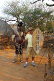 Zulu Chief posing with tourist in Shakaland Zulu Village, South Africa — Stock Photo