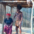 Stock Photo: Zulu warrior with his wife in Shakaland Zulu Village, South Africa