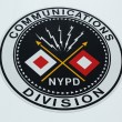 Stock Photo: NYPD Communications Division emblem on command post in Brooklyn, NY