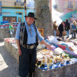 Stock Photo: Street vendor dressed as gaucho offers souvenirs in LBocareof Buenos Aires