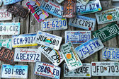 Old car license plates on the wall — Stock Photo