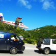 Stock Photo: Dramatic Winair plane landing at St Barts airport