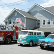 Stock Photo: Fire truck, 1966 Volkswagen Bus Vanagon and old NYPD Plymouth police car on display