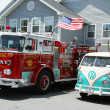 Stock Photo: Fire truck and 1966 Volkswagen Bus Vanagon on display