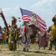 Stock Photo: The Eagle Staff leads the Grand Entry at he NYC Pow Wow in Brooklyn