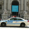Stock Photo: NYPD car in front of National Museum of AmericIndiin Manhattan