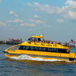 Stock Photo: New York City Water Taxi in front of Ellis Island