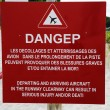 Stock Photo: Danger sign next to runway at St Barts Gustaf III Airport, French West Indies