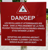 Danger sign next to runway at St Barts Gustaf III Airport, French West Indies — Stock Photo