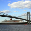 Stock Photo: Queen Mary 2 cruise ship in New York Harbor under Verrazano Bridge heading for Transatlantic Crossing from New York to Southampton