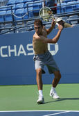 Professional tennis player Jerzy Janowicz practices for US Open 2013 at Louis Armstrong Stadium at Billie Jean King National Tennis Center — Stock Photo