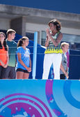 First Lady Michelle Obama joined by professional tennis players at Arthur Ashe Kids Day at Billie Jean King National Tennis Center — Stock Photo