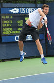 Professional tennis player Ernests Gulbis from Latvia during his first round match at US Open 2013 — Stock Photo