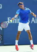 Seventeen times Grand Slam champion Roger Federer during his first round match at US Open 2013 against Grega Zemlja at Billie Jean King National Tennis Center — Stock Photo